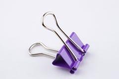 Binder clip. Purple binder clip on white background Stock Image
