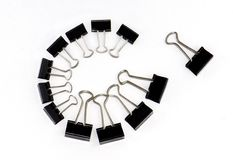 Binder clips in a circle Royalty Free Stock Photo
