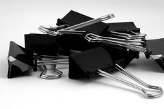 Binder Clips. Large Pile of Binder Clips Monochrome Stock Photo
