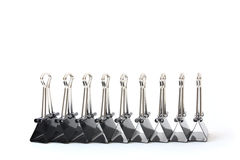 Binder Clips in Profile. A row of Binder Clips on white, profiled Stock Photo