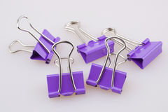 Binder clips. Purple binder clips on white background Royalty Free Stock Photography