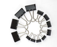 Binder clips in a twirl Stock Photos