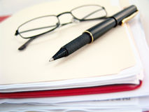 Binder, glasses and pen Royalty Free Stock Photos