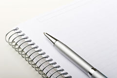 Binder note pad paper sheet with elegant style pen. On top Royalty Free Stock Photography