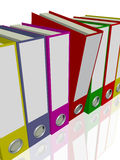 Binders. Various binders in deiverse colors over a white background Royalty Free Stock Image