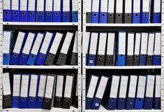 Binders. Office binder folders in shelf Royalty Free Stock Photos