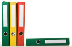Binders. Colorful old binders against white background. Office life Stock Image