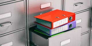 Binders in filing cabinets drawers. 3d illustration Stock Photo
