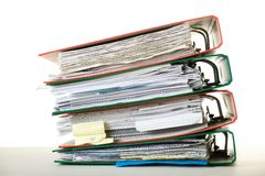 Binders stack. Stack of documents in binders against white background. Office life Stock Images