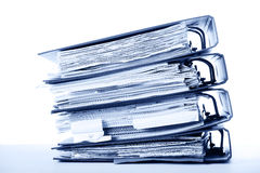 Binders stack. Stack of old documents in binders against white background. Office life. Blue tone Stock Image