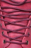 Binding laces in the shoe with a red leather Royalty Free Stock Images