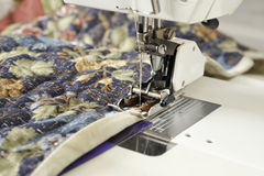 Binding quilt on machine. Stock Photos