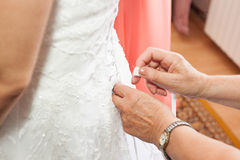 Binding of white wedding dress Stock Image