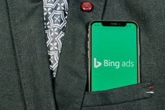 Bing application icon on Apple iPhone X screen close-up in jacket pocket. Bing ads app icon. Bing ads is online advertising applic. Sankt-Petersburg, Russia royalty free stock photo