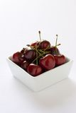 Bing Cherries. Fresh Bing Cheeries a sweet summer snack, cherries are on a white background Royalty Free Stock Images