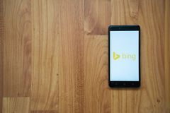 Bing on smartphone. Los Angeles, USA, july 13, 2017: Bing logo on smartphone screen on wooden background Royalty Free Stock Photo
