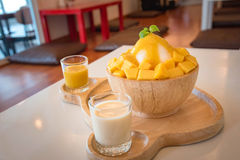 `Bing su` Korean style. Fresh mango shaved ice on wood table Royalty Free Stock Photography