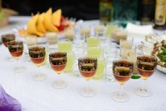 Binge on a buffet table. Drinking different kinds of close-up before a party in a cafe royalty free stock images