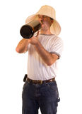 Binge Drinking. A drunk man drinking from a giant bottle Stock Image