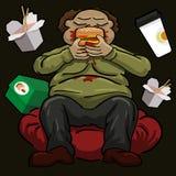 Binge eating. Very busy man sitting and eating hamburger Royalty Free Stock Image