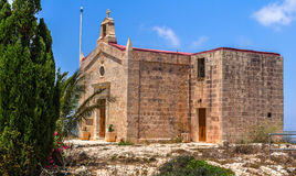 Bingemma Chapel Behind the Trees. The Bingemma chapel dedicated to 'Our lady of Itria' in Malta Stock Photo