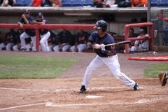 Binghamton Mets batter Jose Coronado watches Stock Image