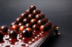 Bingo. Sphere whit  ball 69 on focus  and table whith balls defocused Royalty Free Stock Photos