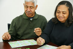 Bingo. People playing bingo with chips and cards Stock Photography