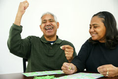 Bingo. People playing bingo with chips and cards Royalty Free Stock Photography
