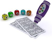 Bingo balls and card with dabber pen Stock Image