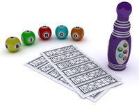 Bingo balls and card with dabber pen Royalty Free Stock Photo