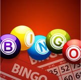 Bingo balls and cards on red background Royalty Free Stock Photography