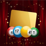 Bingo balls with Christmas gift tag on red velvet background Royalty Free Stock Photo