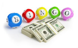 Bingo balls dollars. On a white background Stock Photos
