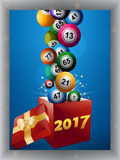 Bingo balls and gift box 2017 panel. Bingo Balls Jumping Out From a Red Gift Box with Golden Ribbon Bow and 2017 Date over Blue Panel with Shadow Royalty Free Stock Photography