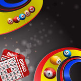 Bingo balls over multi coloured swirl and cards Stock Images