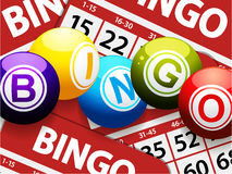 Bingo balls over red bingo cards Royalty Free Stock Image