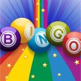 Bingo balls on rainbow over blue background Royalty Free Stock Image
