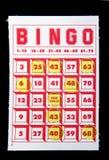 Bingo Card. A bingo card with tokens on a black felt background vector illustration