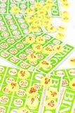 Bingo card arrange with number chip Stock Image