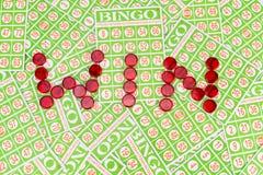 Bingo chip arrange in. Win word on bingo card background Royalty Free Stock Image