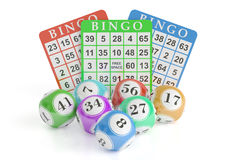 Bingo, lottery balls and cards. 3D rendering. Isolated on black background Stock Image
