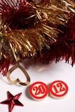 Bingo numbers and christmas ornaments. On white background Royalty Free Stock Photography