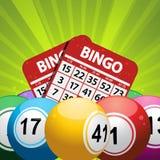 Bingo piłki i karciany tło na zielonym starburst Obrazy Stock
