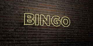 BINGO -Realistic Neon Sign on Brick Wall background - 3D rendered royalty free stock image. Can be used for online banner ads and direct mailers Stock Photography