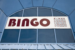 Bingo. A bingo sign is seen against blue colored architecture Stock Photography