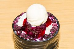 Bingsu snowflake .Korean ice shaving dessert with blueberry stock image