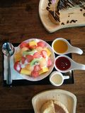 Bingsu, topping mixed fruits. Popular Korean dessert style for all eat lovers. Good for summer time Stock Image