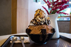 Bingsu vanilla ice cream. Blurred image of a flavor full delicious chocolate bingsu on top with vanilla ice cream with chocolate syrup. Bingsu is a korean Royalty Free Stock Photo