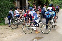 Asian pupil cycling go to school Royalty Free Stock Photos